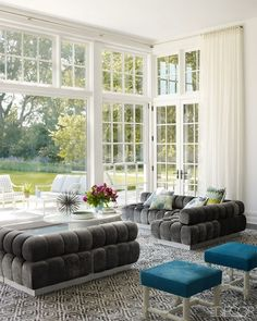 white room/ grey couch/ large windows/ french doors