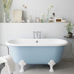 A built-in shelf is perfect for keeping bathroom knick-knacks to hand and creating a pretty display at the same time.