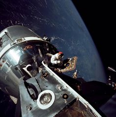 """March 6, 1969: Apollo 9 command module pilot Dave Scott standing in the hatch of command module """"Gumbo"""" during an EVA. 