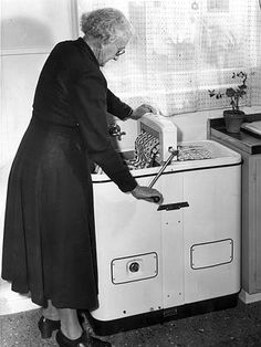 LAUNDRY~M Sowden of Oaklands Park uses wringer-style twin-tub washing machine in