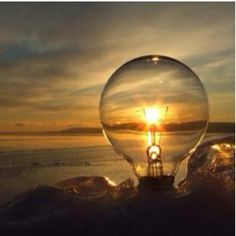 Line up a lightbulb with the sunset and TADA.... Beautiful picture! So clever!