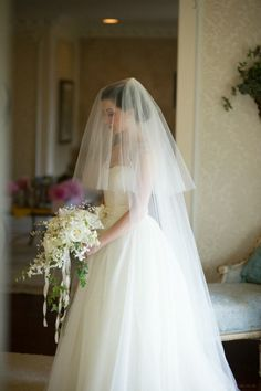 I love this veil and the bouquet.