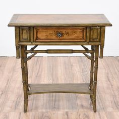 This tropical side table is featured in a solid wood with faux carved bamboo details in a olive brown finish. This end table is in great condition with floral painted details, 1 drawer and 1 bottom shelf. Unique piece perfect as a console table!   #tropical #tables #endtable #sandiegovintage #vintagefurniture