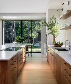 gorgeous natural woods and fresh greenery enhance this stunning modern kitchen design Mowery Marsh Architects Gorgeous kitchen decorating & design ideas, from cabinet choices to lighting, modern to classic, this gallery of kitchen images will inspire! Home Decor Kitchen, Kitchen Interior, Home Kitchens, Kitchen Ideas, Kitchen Inspiration, Diy Kitchen, Modern Kitchens, Kitchen Layout, Kitchen Hacks
