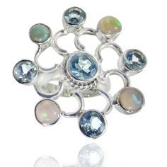Designer ring featured with natural blue topaz and ethiopian opal gemstone