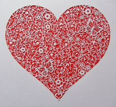 A hand cut papercut heart featuring lady birds, butterflies, flowers, hearts and love! (copyright Clare Willcocks)