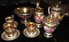 19th century COFFE SET in porcelain Old Paris with flower decoration in bright colors and gold to fine gold.Composed of: coffee maker, milkmaid, sugarero, six services and a fruit bowl.