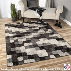 Halo Blocks Gray is the perfect rug for any modern household. It includes black, gray, silver, ivory, slate and charcoal for a modern color combination. With its look and its soft, lush pile this rug is the perfect addition to any household...