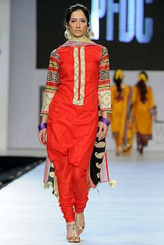 Ittehad Collection at PFDC Sunsilk Fashion Week 2012 Day 3. Plain red suit with printed sleeves.