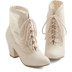 You're in a stylish hurry in these time-traveling ivory booties by Bait Footwear! In addition to a silhouette that evokes the Victorian era, these vegan faux-l…