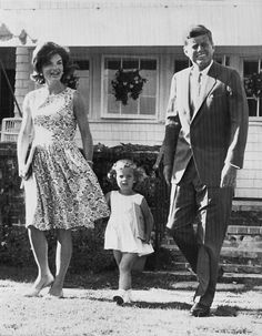 Senator John F. Kennedy (D-Mass.), Democratic presidential candidate, walks across the lawn with his wife Jacqueline and daughter Caroline, 2 1/2, at their Hyannis Port home, July 21, 1960. Look at pregnant Jackie…so cute