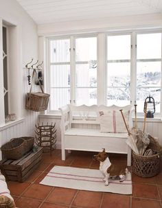 love the white and light with vintage bottle drying rack and grainsacks