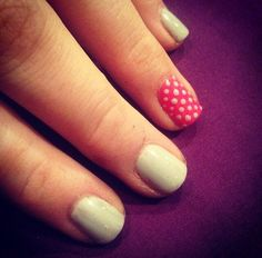 Pink & grey polka dots on the ring finger, so cute.  by Evie at Tranquility spa Hornchurch, Essex