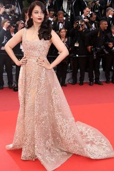 Aishwarya Rai Bachchan The Bollywood star stunned onlookers in this soft pastel gown with floral patterns trailing onto the red carpet.