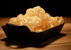 Crunchy Pig Skin Popcorn ~ These deep-fried pork skin bits are happy to accompany you to your cocktail.