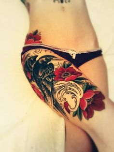 Beautiful!  thigh tattoo | bird tattoo | flower tattoo | red tattoo | rose tattoo | tattoo ideas | tattoo inspiration