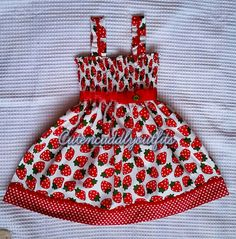 A Beautiful Strawberry Dress featuring little strawberries with all over in red and green against white background, for your little princess.      This dress is smocked at the top edge, and fits perfectly without any fastening so a must have for little babies who lie for most of the time.  Decorated with high quality ribbon and bows. The dress comes with a matching headband.     Made from a cotton fabric, machine washable on a cool wash, do not tumble dry.    This listing is for sizes 0-2…