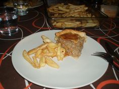 Meat empanada with fries