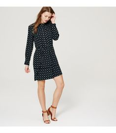 """In a mesmerizing botanic print, this fluid shirtdress is finished with a covered button placket for put-together polish. Collarless Long sleeves with button cuffs. Covered henley button placket. Removable waist tie. Back yoke with box pleat. 21"""" from natural waist."""