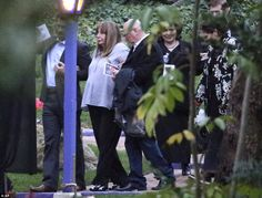 Legend: Penny Marshall (above) gets some help as she is escorted out after the memorial se...