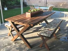 I want to make this!  DIY Furniture Plan from Ana-White.com  Free simple step by step project plans to do it yourself and build a x bench, inspired by Pottery Barn's Chesapeake Rectangle bench. Features modern or contemporary picnic table styling, these sturdy x benches are easy to build and stylish.