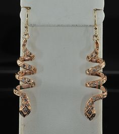 Delightful Victorian style .70 Ct diamond long coiled snake earrings. Offered by hawkantiques, via Etsy.