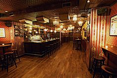 Idea for the speakeasy. Note the different heights of the ceiling and the rich color palette.