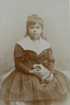 Young girl with pet guinea pig - Germany, 1900s
