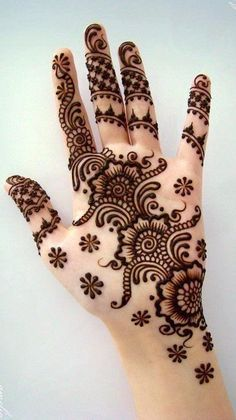 Mehndi designs, known as Henna in the west, are temporary, superficial skin decorations that were first practiced in the Middle East and North Africa a few millenniums ago. The leaves of henna plan. Henna Hand Designs, Mehandi Designs, Mehndi Designs For Beginners, Mehndi Designs For Girls, Mehndi Design Images, Beautiful Mehndi Design, Arabic Mehndi Designs, Latest Mehndi Designs, Simple Mehndi Designs
