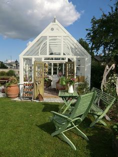 Isa's Garden: Greenhouse Inspiration - gorgeous out building, with space for dining!  This post has lots of inspiring pictures!