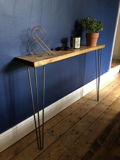 A rustic yet sleek and elegant handmade wooden scaffold board console/side table complete with 2 x quality strong 3 rod british made steel eames style hairpin legs. Wooden Storage Shelves, Rustic Shelves, Shelving, Hallway Shelf, Hallway Storage, Hallway Ideas, Cloakroom Storage, Ikea Hallway, Credenzas