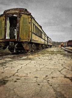 Old railroad cars are lined up awaiting restoration at the North Carolina Transportation Museum in Salisbury, North Carolina.