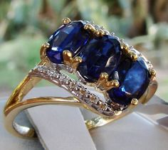 Solid 10k Gold Himalayan Kyanite Trilogy Ring 1.96cts  Such a Beautiful and Elegant Ring!   Beautiful genuine and all natural Himalayan Kyanite with amazing color and incredible clarity in a stunning Solid 10k yellow gold setting. A very wearable piece!  Visit my eBay store for this and more beautiful genuine gemstone jewelry. http://stores.ebay.com/HM-Fine-Jewelry-And-More