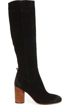 A stacked cylindrical heel accentuates the clean-lined silhouette of a knee-high boot crafted from supple suede.