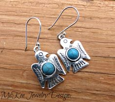 Blue stone turquoise and silver bird earrings.