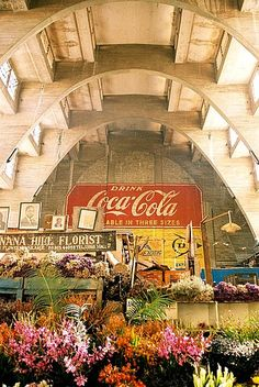 City Market, Central Nairobi, Kenya. Indoor market featuring, curios, flowers, fruit and vegetable stalls
