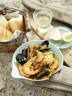 From the book 'Jan Braai - Fireworks' and as seen on the Hermanus episode of the Jan Braai TV series, the Spanish Paella recipe for a braai. Braai Recipes, Fish Recipes, Seafood Recipes, Seafood Paella, Paella Pan, Spanish Paella Recipe, Fish Dishes, Seafood Dishes, South African Recipes