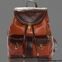 Marino Orlandi   Lavishly styled bag is made of the thick glazed vachetta leather combination - coveted cognac brown leather accented by dark brown leather trim. Distinctive stitching and embossed designer logo on dual front pockets make a bold statement.  $485.00