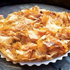 Apple Croustade (Flaky Apple Tart) - Crisp, paper-thin sheets of phyllo dough wrap and crown tender, brandied apples in this classic French tart