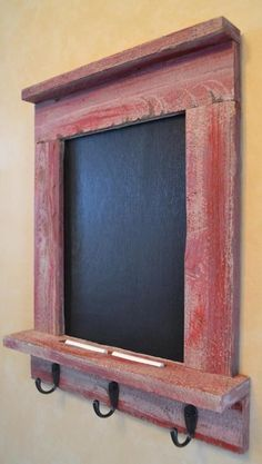 Our organizer, made from salvaged wood, features a large painted chalkboard area for notes and messages, a ledge shelf on the bottom to hold the chalk and other small items, and 3 hooks for keys, coats, bags, etc. Perfectly designed and sized for your ent