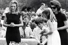 John with his sister, mother, and aunt, Lee Radziwill, at Bobby Kennedy's grave, Arlington National Cemetery, June 9, 1968.