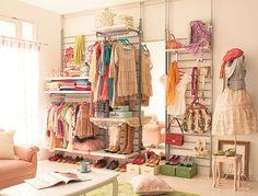 I want a closet like this... a closet, not a living room. :D