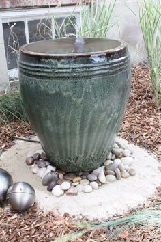 We made this: Well okay, we didn't throw that pot. I just mean that we made this pot into a fountain. It's a little subtle and hard to tell from pictures, but the water bubbles up in th…