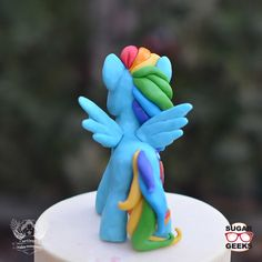 Learn how to sculpt a perfect Rainbow Dash My Little Pony cake topper using yummy modeling chocolate and fondant!