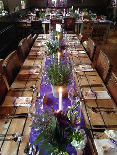 Lavender pots & flowers made a beautiful centrepiece arrangement on these long tables at The Battleaxes.  Styling: www.littleweddinghelper.co.uk