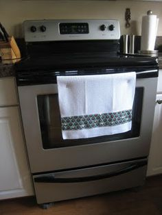 Add snaps to kitchen towels so that kids can't pull them off the oven handle. Genius!