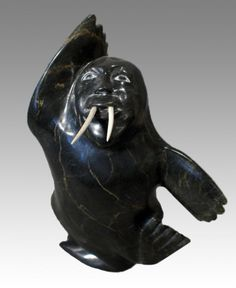 """Walrus Spirit by Inuit artist Kelly Qimirpik, Style: Transformation Art, Location: Kinngait (Cape Dorset),  Year: 2007, Material: Stone and ivory, Dimensions: H 15"""" X W 10"""" X D 4.5"""" $3000"""