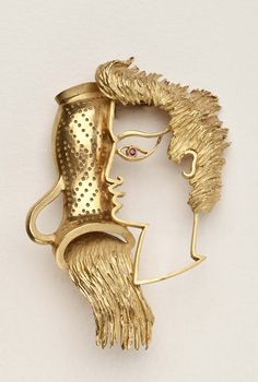 Jean Cocteau Gold Brooch ~ An 18 karat clip brooch by French artist and stage designer, Jean Cocteau (1889-1963). Cocteau designed this brooch of a woman (?) in profile pouring a jug of water in the late 1950's and had it produced by Fred, a famous Parisian jeweler. It is thought to be a reference to the zodiac icon Aguarius