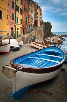 INGE JOHNSSON › PORTFOLIO › Riomaggiore Boat by Inge Johnsson Boat in small coastal town of Rio Maggiore in Italy's Cinque Terre national park Camera/lens: Canon 5D, Canon TS-E 24/3.5L