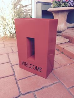 Welcome planter box. Powder coated in flame red. 750x 450x250mm